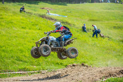 Quad racer jumping Stock Photography
