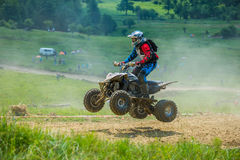 Quad racer jumping Royalty Free Stock Photography
