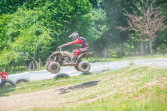Quad racer jumping Stock Photo
