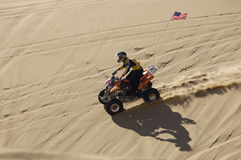Quad Racer Riding Over Sand Dune Royalty Free Stock Photography