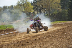 Quad racer with smoke from the engine Royalty Free Stock Photo