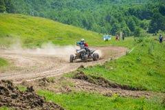Quad racer. Taking turn. Event from 20.05.2015 in Moreni, Dambovita, Romania Royalty Free Stock Photography
