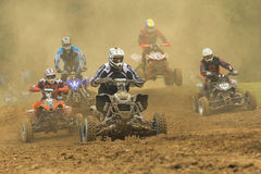 Quad racers. JEVICKO, CZECH REPUBLIC - JULY 23. Unidentified racers rides a quad motorbike in the Crossracing Cup 2011 on July 23, 2011 in the town of Jevicko Royalty Free Stock Photography