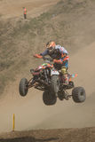 Quad rider in a high jump. Vertically. Stock Photography