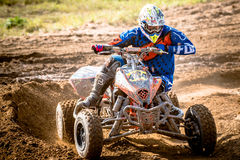 Quad rider on the race Stock Images