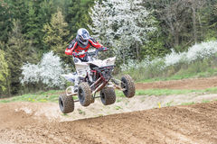 Quad rider in red is jumping Stock Photo