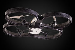 Quad rotor drone. A small spy quad copter drone flying over a dark background royalty free stock images