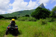 Quad safari by the mountain. A quad safari ride by the mountain in Casela, Mauritius Stock Images
