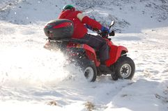 Quad in snow. Man riding quad in mountain snow Royalty Free Stock Images