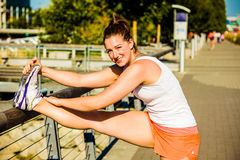 Quad stretch on rail - tight shot Royalty Free Stock Images