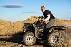 Quad - teen driving four wheeler royalty free stock photo
