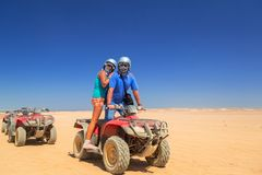 Quad trip on african desert. Of Egypt Royalty Free Stock Image