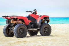 Quad vehicle on the beach Royalty Free Stock Photography