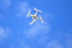 Quadcopter on the blue sky Royalty Free Stock Image
