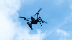 Quadcopter with camera flying on a clear sunny sky sunset backgr Royalty Free Stock Image