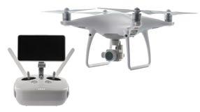 Quadcopter del abejón del vuelo aislado en blanco con la trayectoria de recortes Fotografía de archivo