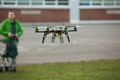 Quadcopter Drone flying in an urban area Stock Photo
