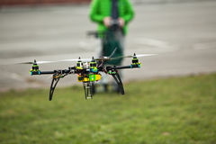 Quadcopter Drone flying in an urban area. Homemade quadcopter drone flying in an urban area stock photography