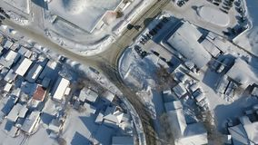 Quadcopter flies over the winter houses. Water Park in Novosibirsk. Road stock video
