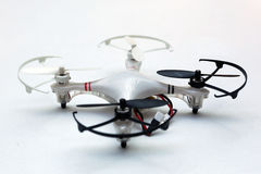 Quadcopter - a flying drone. A flying drone, quadcopter, isolated on a white background stock images