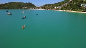 Quadcopter Flying over Kayaking Group in Open Sea. Exercising for Championship. Drone Aerial View HD. Phuket, Thailand. stock footage