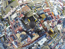 Quadcopter flying over roofs Stock Image