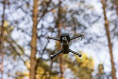quadcopter in the forest royalty free stock photos