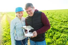 Quadcopter outdoors, aerial imagery fun hobby, recreation concept - fun of flying drone and videos laugh young man and Royalty Free Stock Image