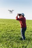 Quadcopter outdoors, aerial imagery and recreation concept - close contact between human and robot, hovering drone and Royalty Free Stock Photos