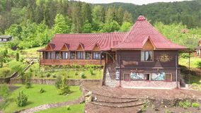The House on The Territory of a Tourist Complex. Quadcopter shoots a house facade for rest in the territory of a tourist complex. At the left a part of stock footage
