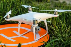 The quadcopter sits on the landing pad stock images