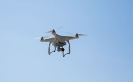 Quadcopter in the sky. Fly quadcopter in the sky Stock Photo