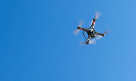 Quadcopter in the sky. Fly quadcopter in the sky sunset Royalty Free Stock Photo