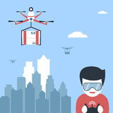 Quadcopterwith boc flying above town and a boy with remote controle in hands Royalty Free Stock Image