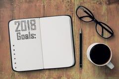 Quaderno con una lista di 2018 scopi Immagine Stock