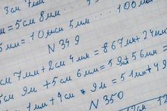Quaderno di uno studente con i numeri Fotografia Stock
