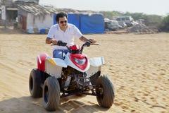 Quading on Goan Beach Royalty Free Stock Image