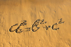 Quadratic equation handwriting on the sand. Stock Photography