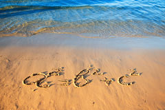 Quadratic equation handwriting on the sand. Royalty Free Stock Images