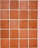 Quadratische Backsteinmauer Stockfotografie
