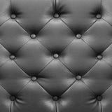 quadratische elegante graue lederne Beschaffenheit mit Knöpfen für Hintergrund Lizenzfreie Stockfotos