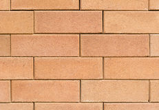 Quadratische orange Backsteinmauer Stockbild
