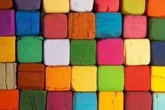 Quadratische Pastelle gefüllt mit Schirmen lizenzfreies stockbild