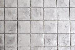 Quadratische Steinbeschaffenheit deckt Hintergrund mit Ziegeln Lizenzfreie Stockbilder