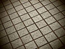 Quadratische Ziegelsteine im Grau mit Splintlochkameraeffekt Lizenzfreies Stockbild