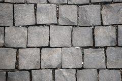 Quadratischer Felsen des Kopfsteins Stockbild