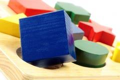 Quadratischer Stöpsel in einem runden Loch Lizenzfreie Stockbilder