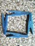 Quadrato del fondo della carta da parati della molletta da bucato fotografia stock