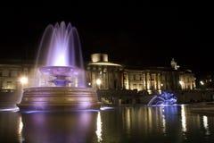 Quadrato di Trafalgar - di Londra nella notte Fotografia Stock Libera da Diritti
