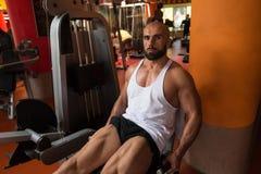 Quadriceps Exercises Close Up. Man Doing Leg With Machine In Gym - Leg Exercises Royalty Free Stock Images